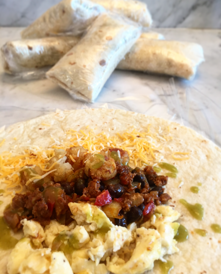 This Chorizo Tater Tot Freezer Breakfast Burritos are packed with cheese, eggs, chorizo, and tater tots. Plus, they last in the freezer for 3 months. SO goo.