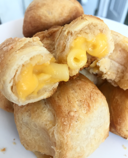These Mac and Cheese Stuffed Bread Bombs use crescent rolls and frozen mac and cheese. Plus, they're super easy to make.